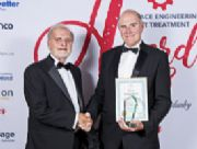 Richard receiving the award presented by Alan Hick