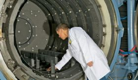 Frank Skelton Inspecting a Vacuum Furnace